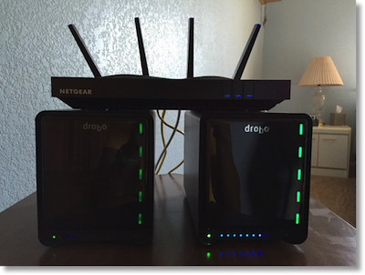 Netgear X8 sitting on top of two Drobos