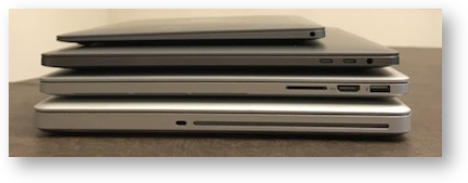 Four macbooks side view