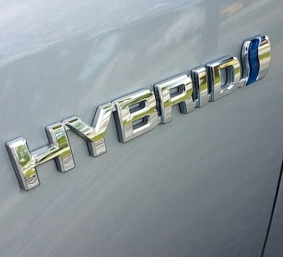 hybrid on the side of a car