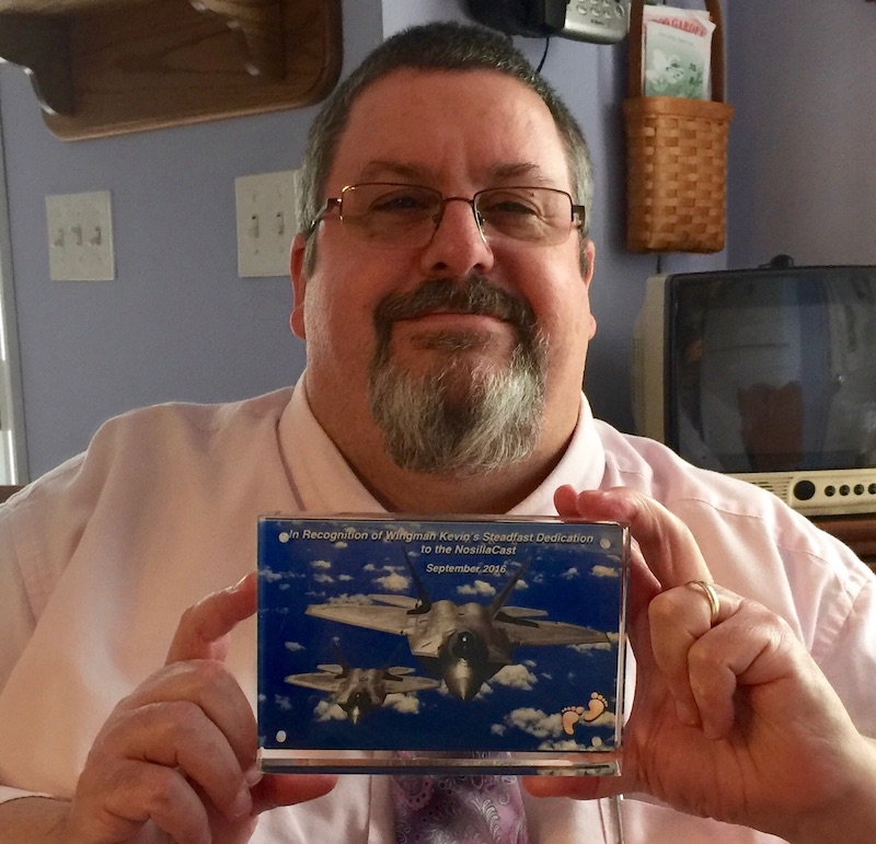 Kevin holding the Wingman plaque Steve made for him
