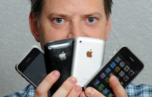 Mark Fawcett holding iPhones