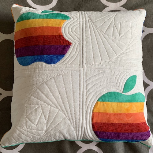 Sandy pillow Apple logos