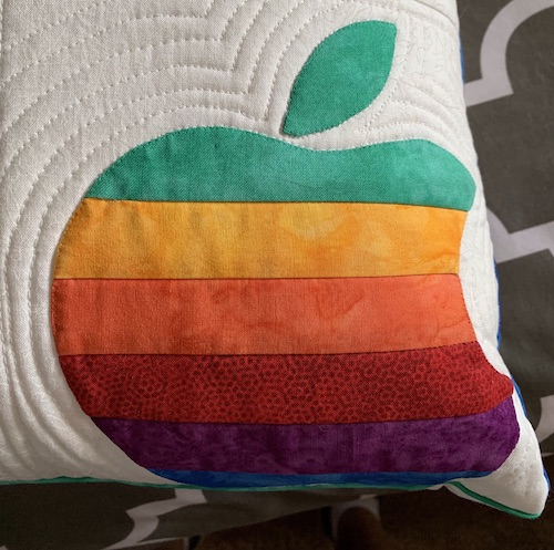 Sandy pillow closeup apple logo