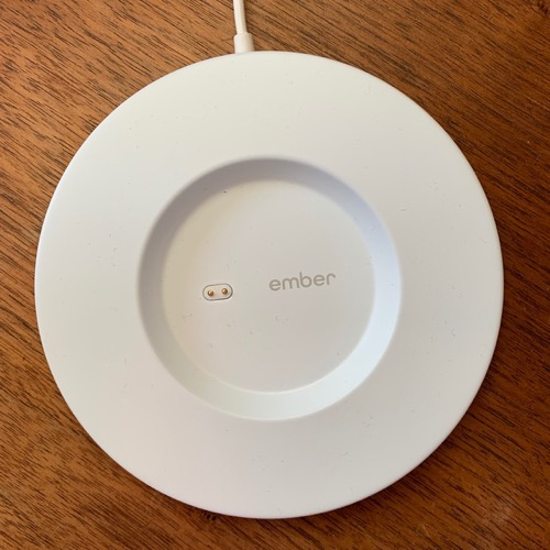 Ember mug coaster showing pins