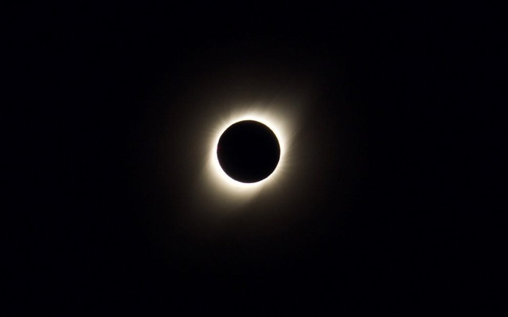 Total Eclipse showing white bands longer at the electromagnetic poles