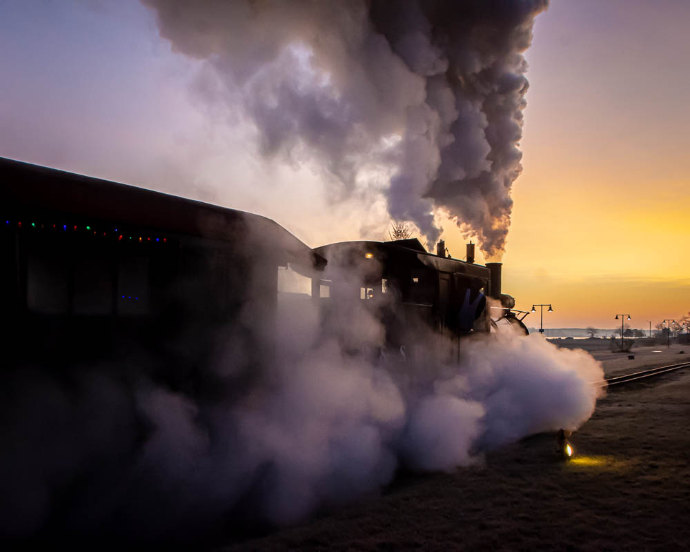 Steam engine into sunset