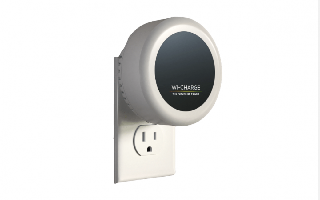 Wi-Charge Wireless IR Transmitter Plugged into Wall Outlet