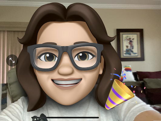 Allison as a live Memoji with party favor