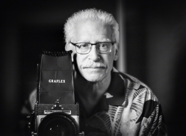 Doug Kaye with a Graflex camera in black and white