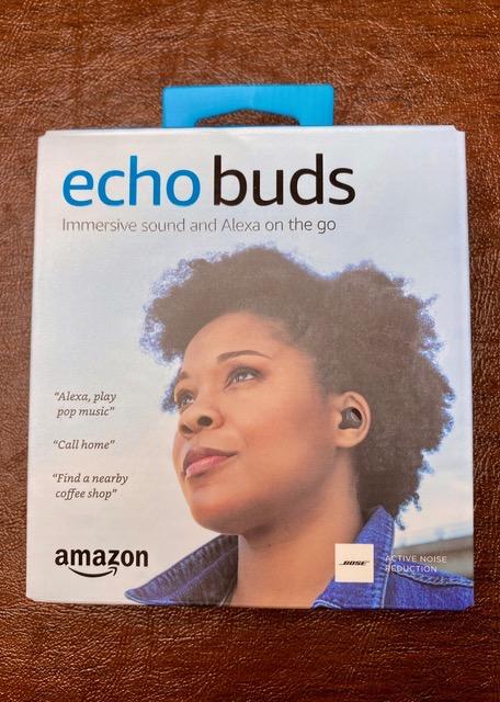 Echo Buds outside box showing woman wearing them