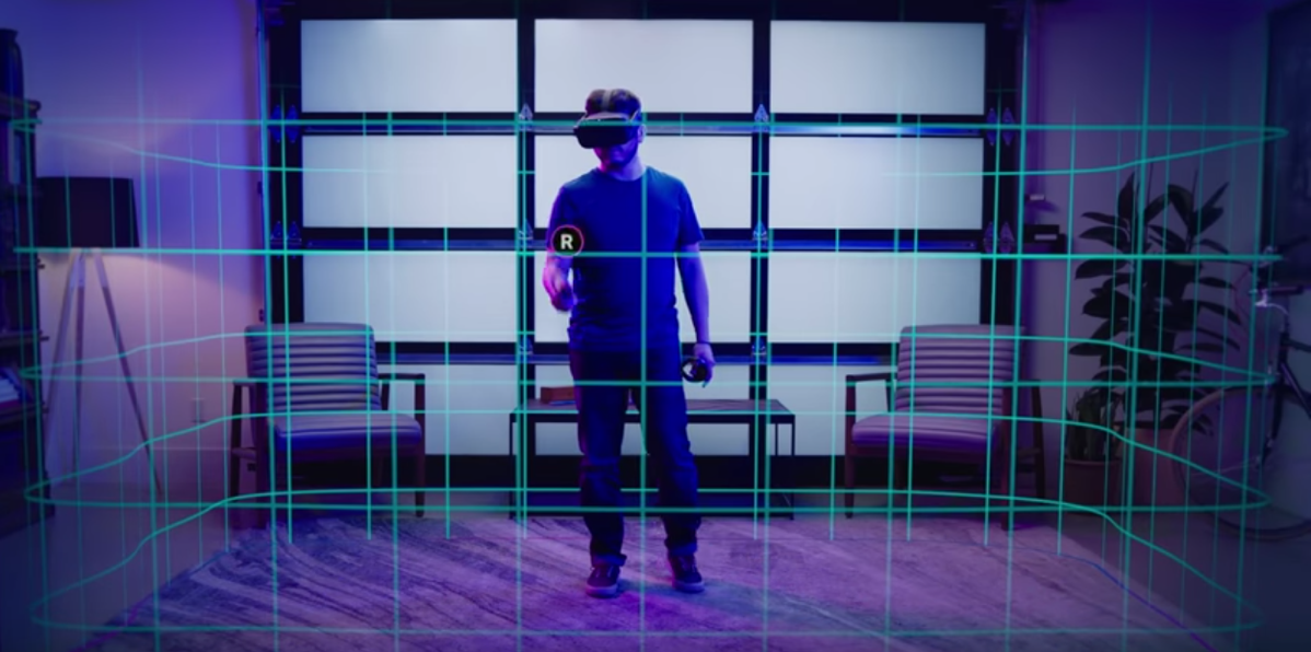 man standing with controller and headset in a room with a green grid in space around him