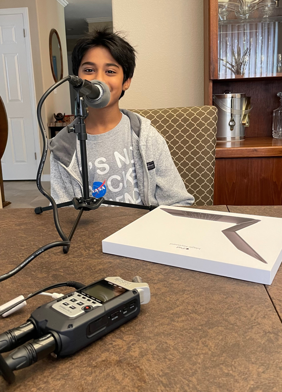 Armaan at the Mic wearing a NASA shirt that says it is not rocket science