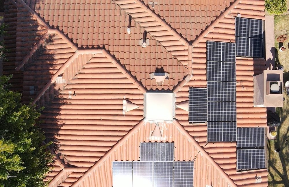 Sheridan roof with 22 solar panels surrounded by Spanish-style ceramic tiles