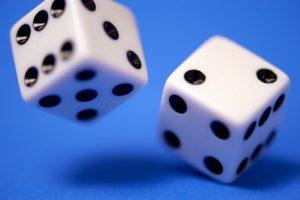 Photo of rolling dice by Edge2Edge Media on Unsplash